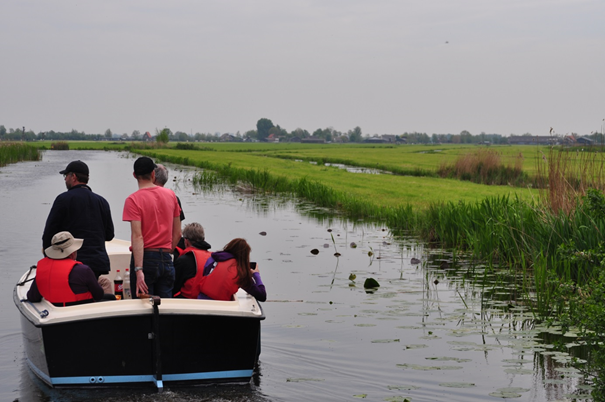 Boat on dutch polder waterway